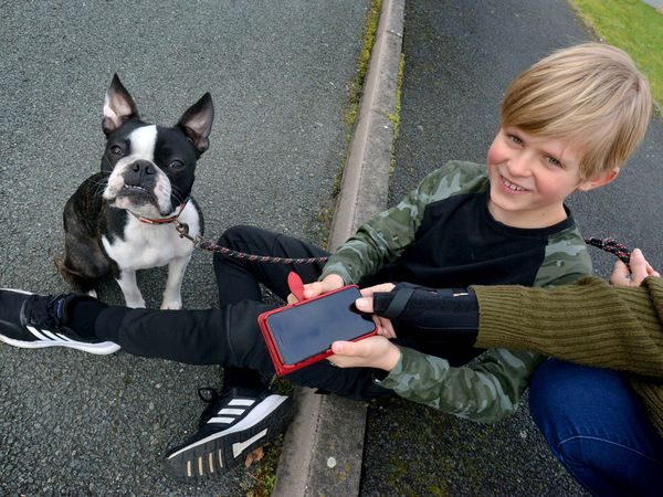 LAST COPYRIGHT SHROPSHIRE STAR STEVE LEATH 05/02/2021..Pic in Donnington of Oakley Hughes 9 and dog: Ragnar. He was quick thinking when Mom tripped over the dog, then passed out in the house with a fractured wrist. Oakley used his moms thumb to unlock the phone and call the Emergency services..