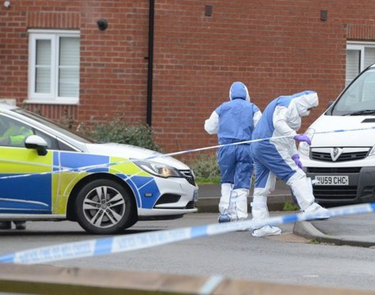 Police at the scene in Farmers Gate, Newport, after Mrs Hooper's death