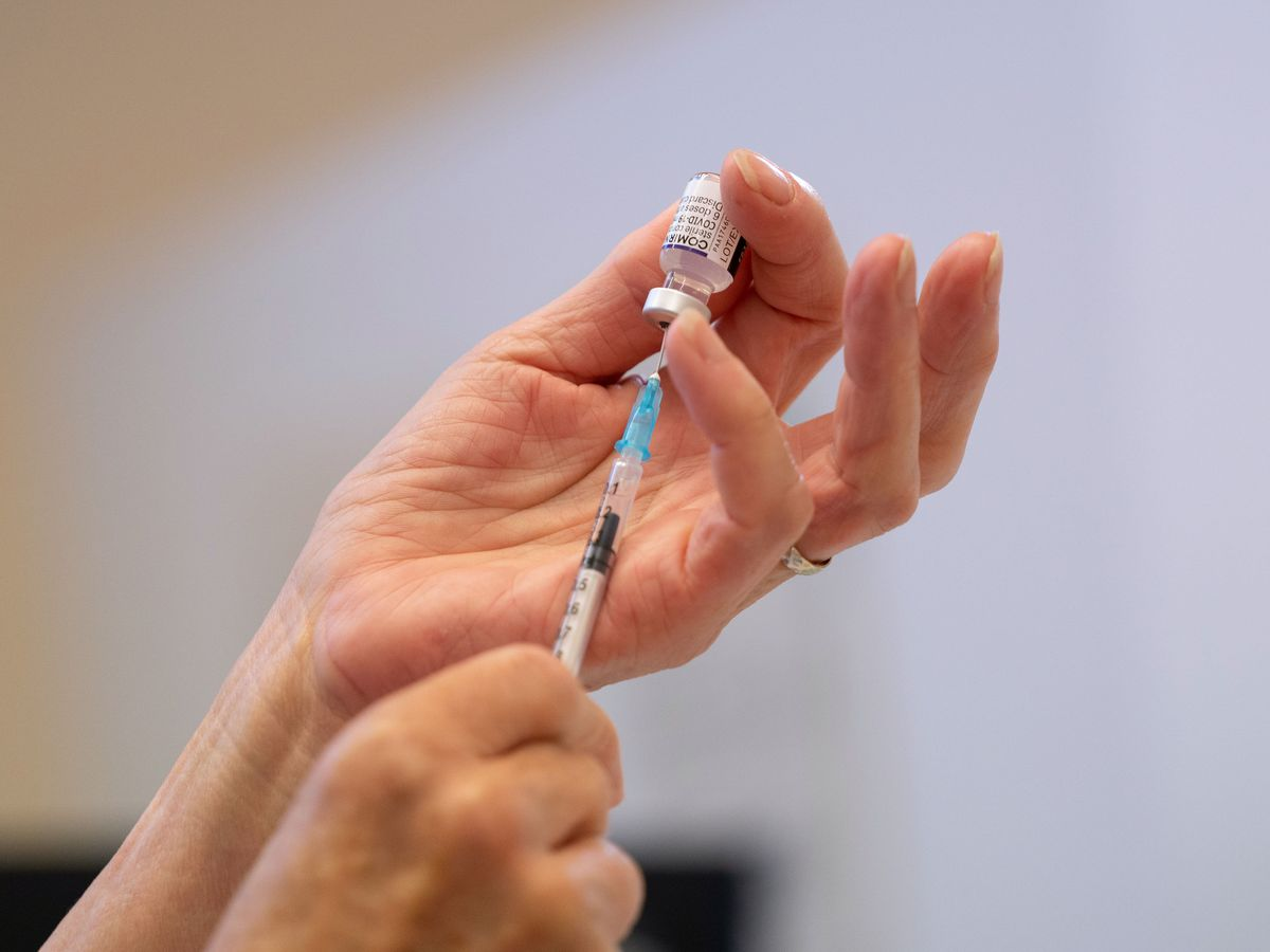 A vaccine shot being prepared