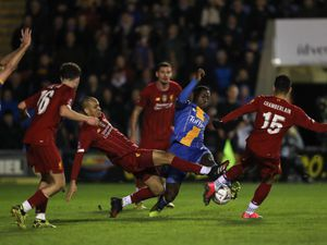 Daniel Udoh of Shrewsbury Town and Fabinho and Alex Oxlade-Chamberlain of Liverpool.