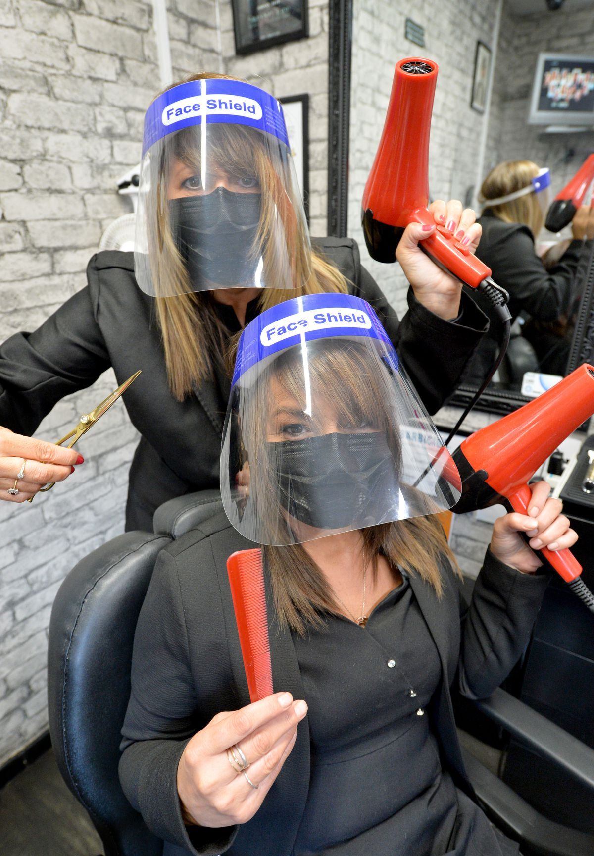 Charlotte Pritchard (left) and Kerry Evans have been business partners for more than 15 years. They run Boys2Men Traditional Barbers in Heath Hill, Dawley