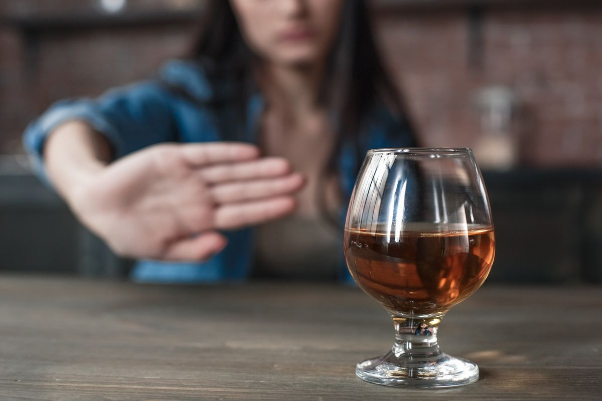 Generic stock photo of a woman saying no to alcohol.