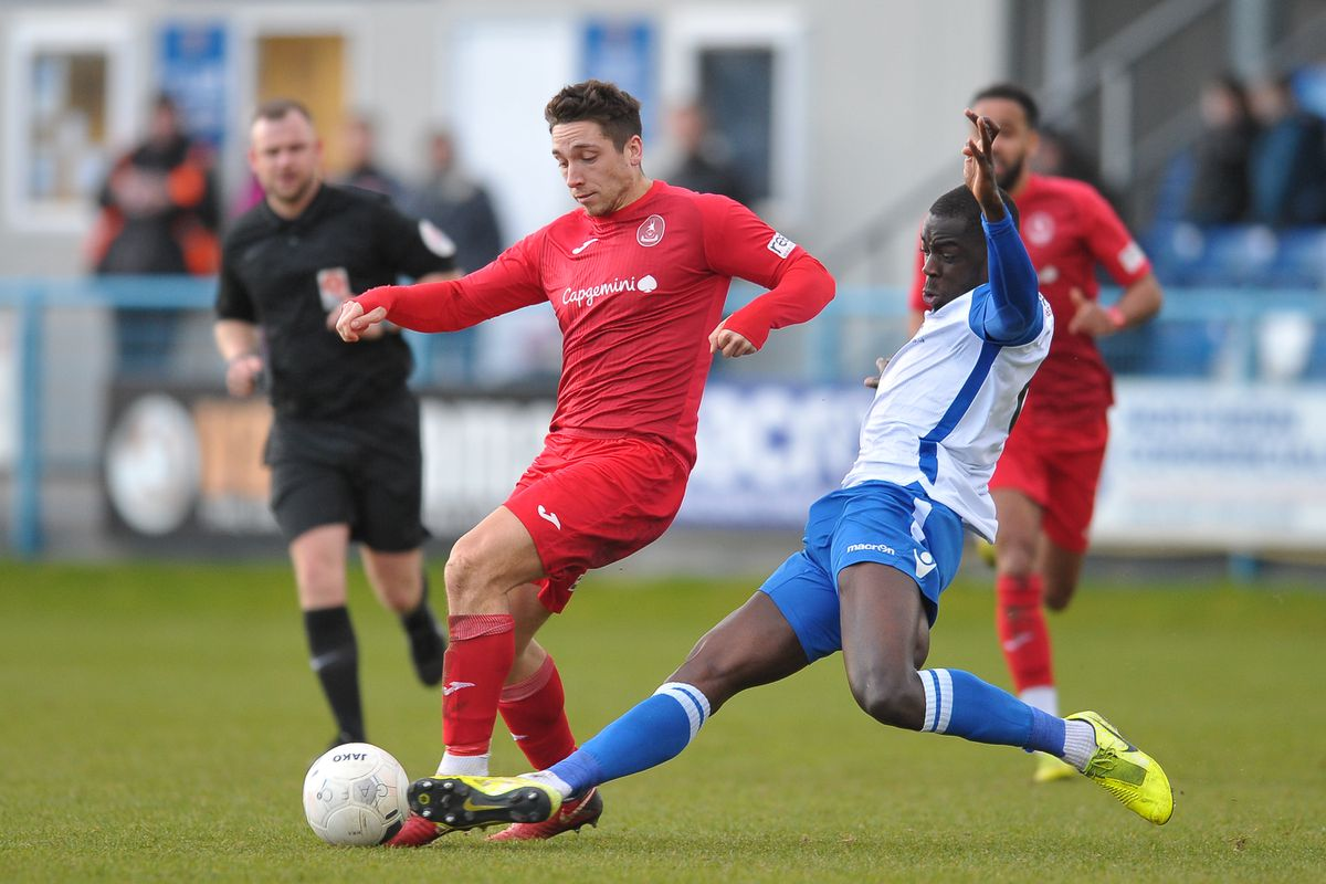 Adam Walker of Telford is tackled by Kennedy Digie (Picture credit: Mike Sheridan/Ultrapress)