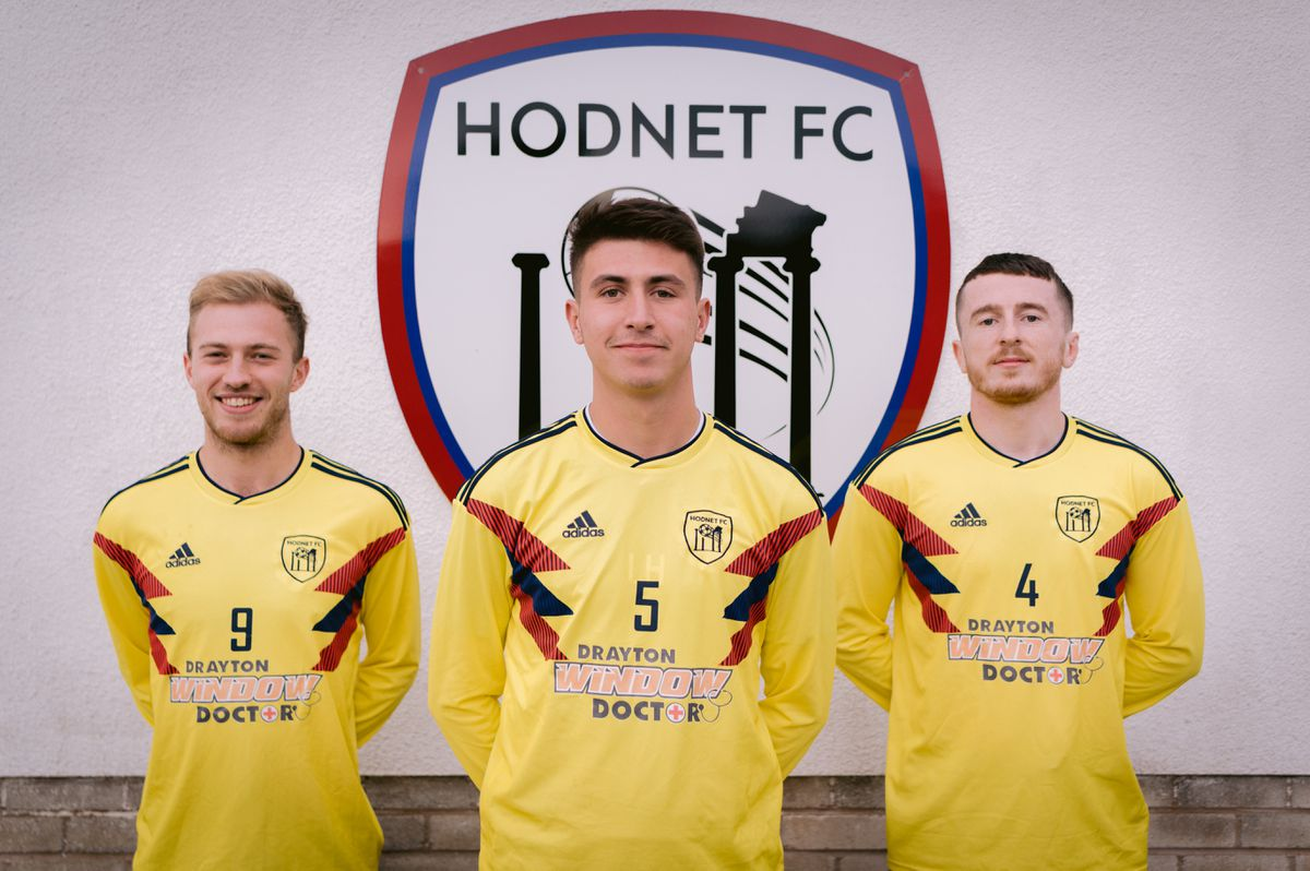 Hodnet FC captain Levi Hunter with players James Billington and Nathan Brayford (Photo: Aaron Evans Photography)