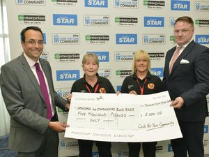 Shropshire Star editor Martin Wright (left) and Enterprise Flex-E- Rent managing director Danny Glynn (right) hand over £5,000 to Lynne Stone and Cheri Williams from the Shropshire and Staffordshire Blood Bikes during last year's campaign
