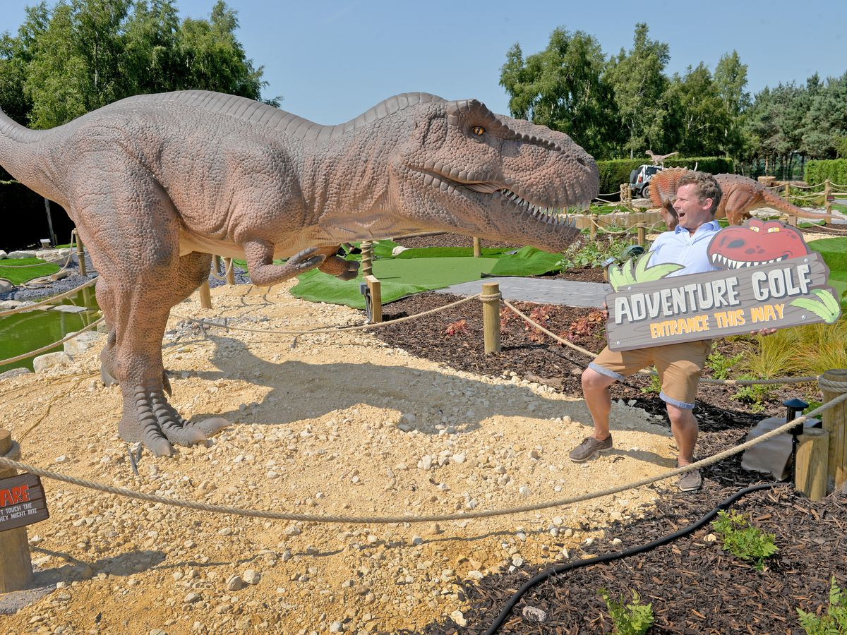 Wolverhampton Adventure Golf director Mark Allen comes face-to-face with a T-Rex