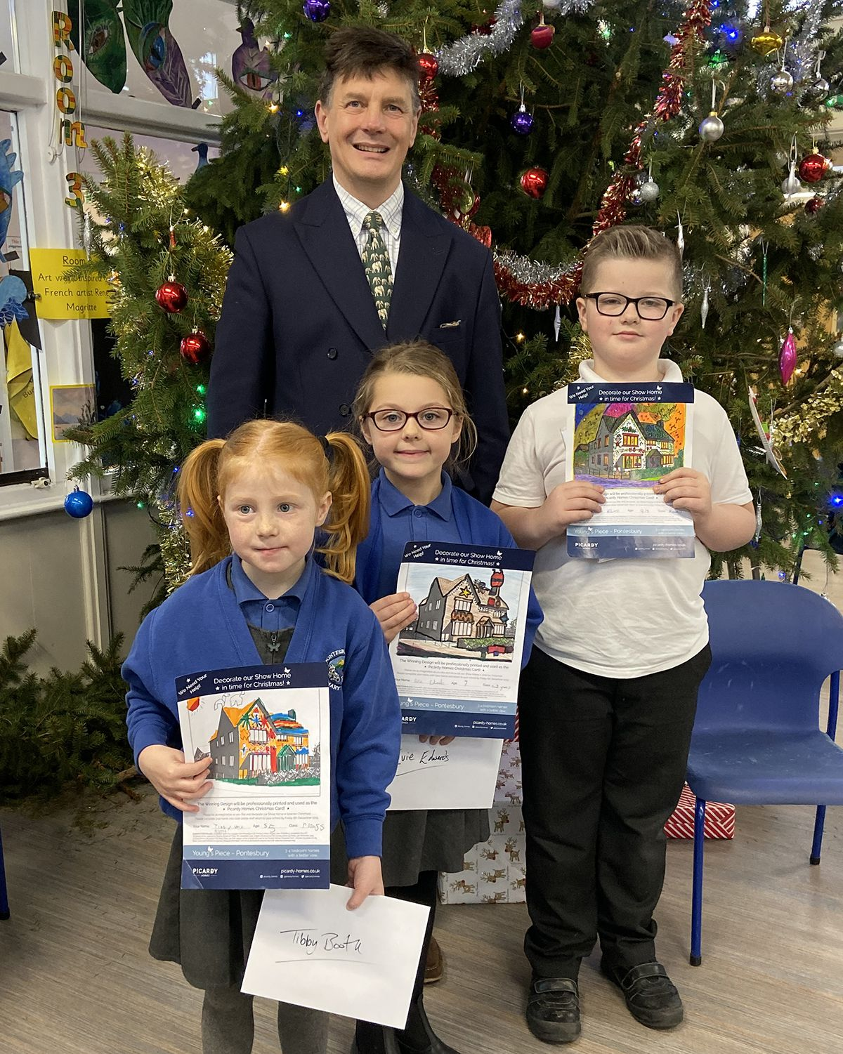 Picardy Homes Director Richard Cambray with the three winners from Pontesbury C of E Primary School