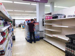 Empty shelves in Sainsbury's, Meole Brace, Shrewsbury as shoppers are being asked not to panic
