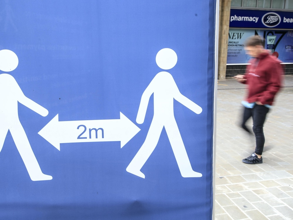 A social distancing sign in Leeds city centre