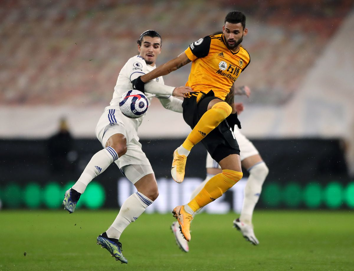 Leeds United's Pascal Struijk and Wolverhampton Wanderers' Willian Jose battle for the ball (PA)