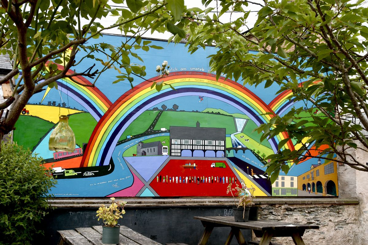 A 17.5ft x 8ft Llanidloes mural has recently appeared in a community garden belonging to Compton's Yard Trust.