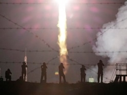 Russian capsule carrying three astronauts docks with space station