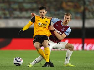 Rayan Ait-Nouri of Wolverhampton Wanderers and Tomas Soucek of West Ham United.