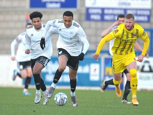 Kole Hall of Telford sprints clear of Alex Whitmore of Fylde