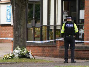 A policeman guards the church where Sir David Amess died