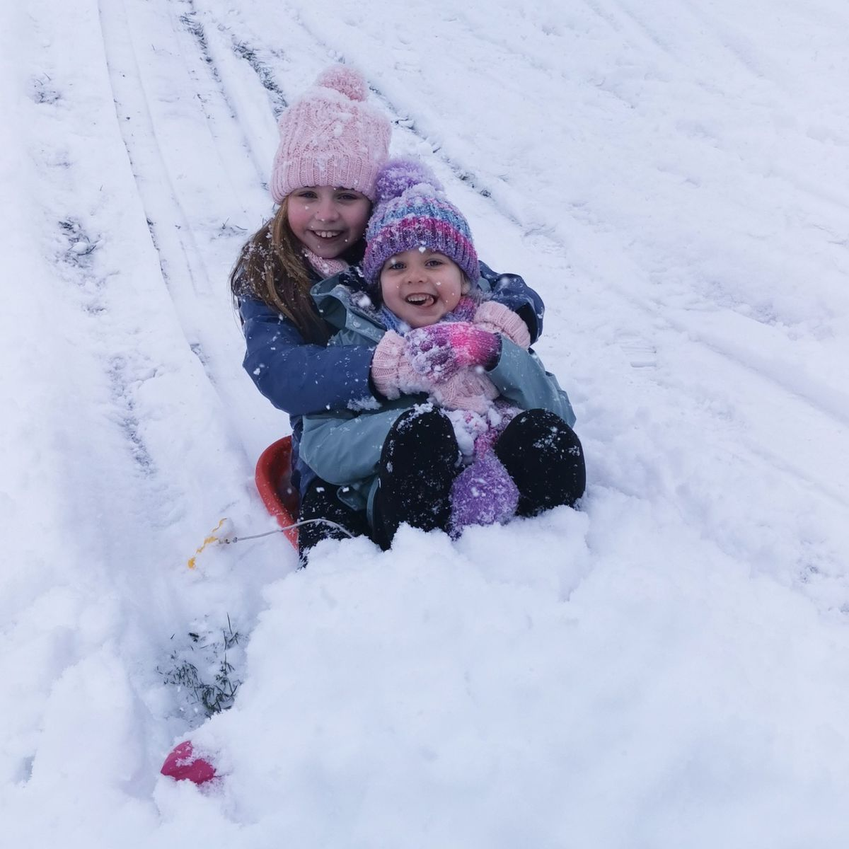 Lyndsey Parry's girls Ella and Lacey enjoying the snow in Oswestry