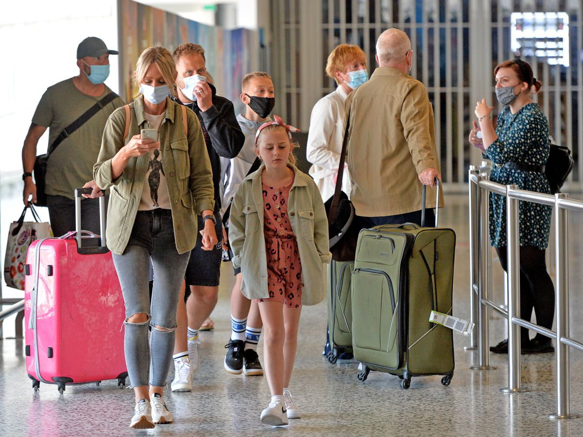 Holidaymakers return home from Portugal