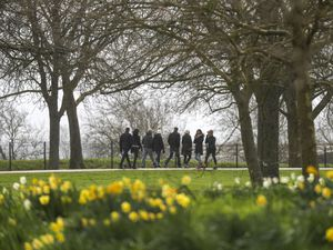 People exercise on the Long Walk in Windsor