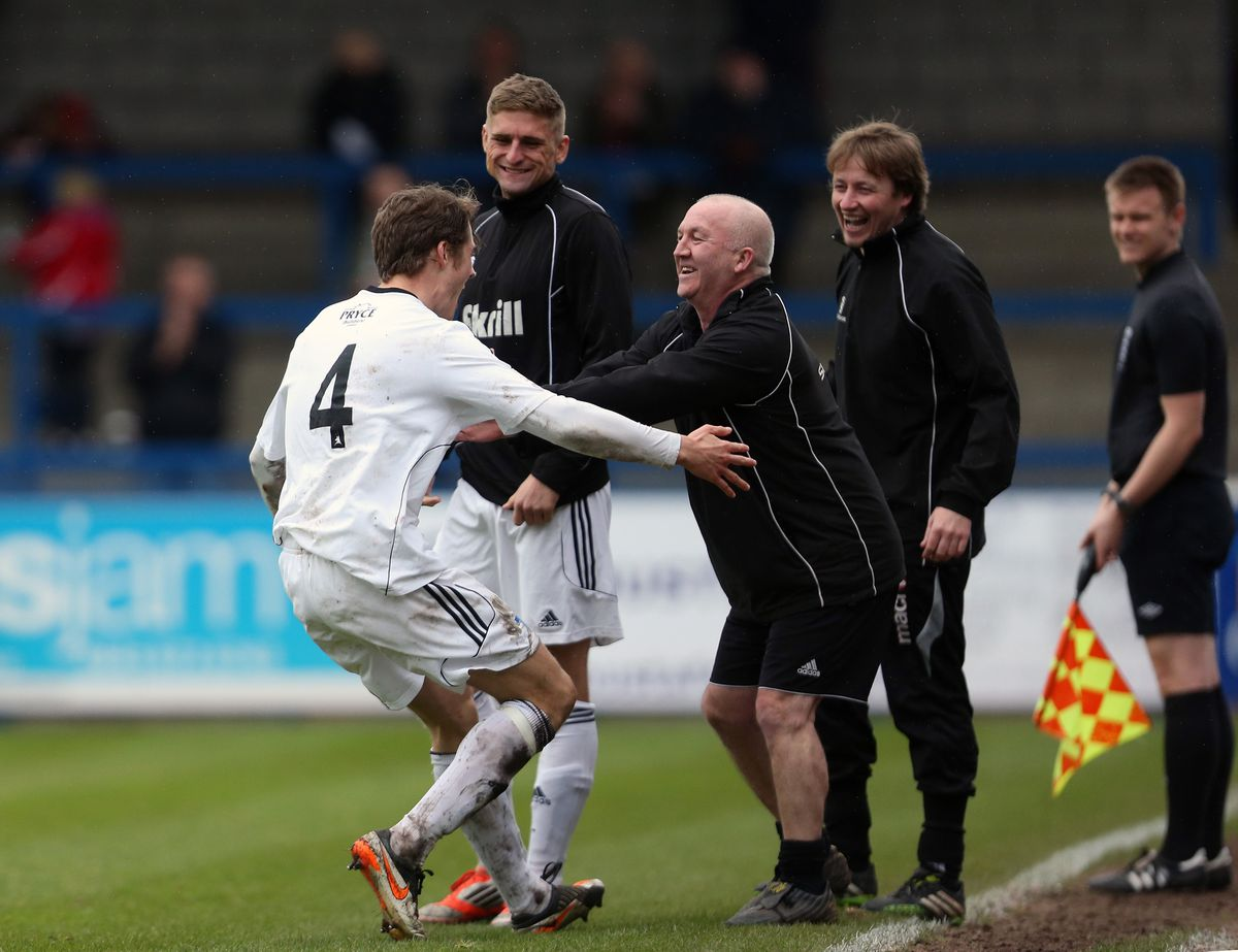 Neill Byrne of AFC Telford United celebrates after scoring a goal to make it 2-0 with Telford physio Chris Roberts.