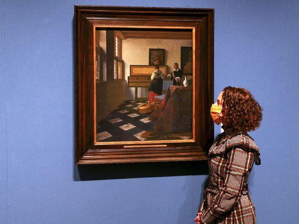 Woman looks at Vermeer painting