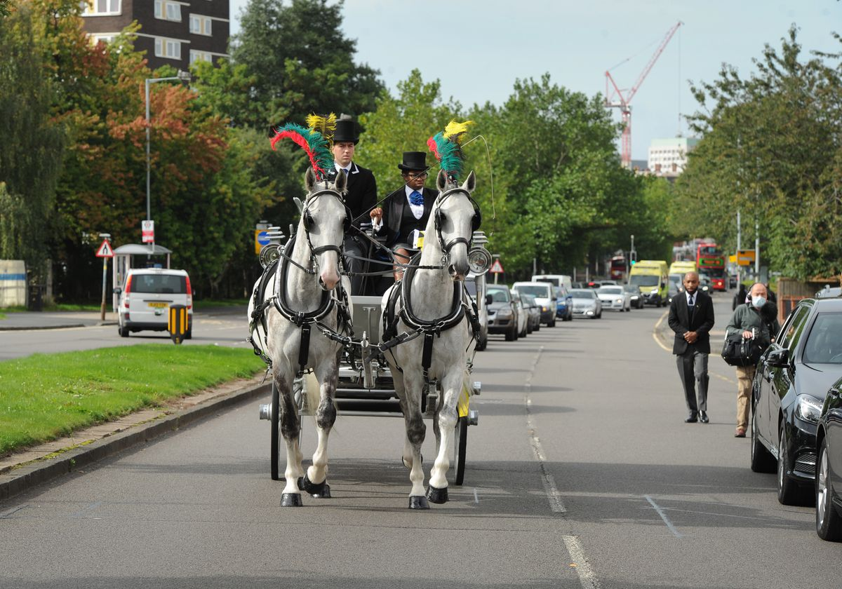 Her coffin was placed in a white carriage pulled by horses