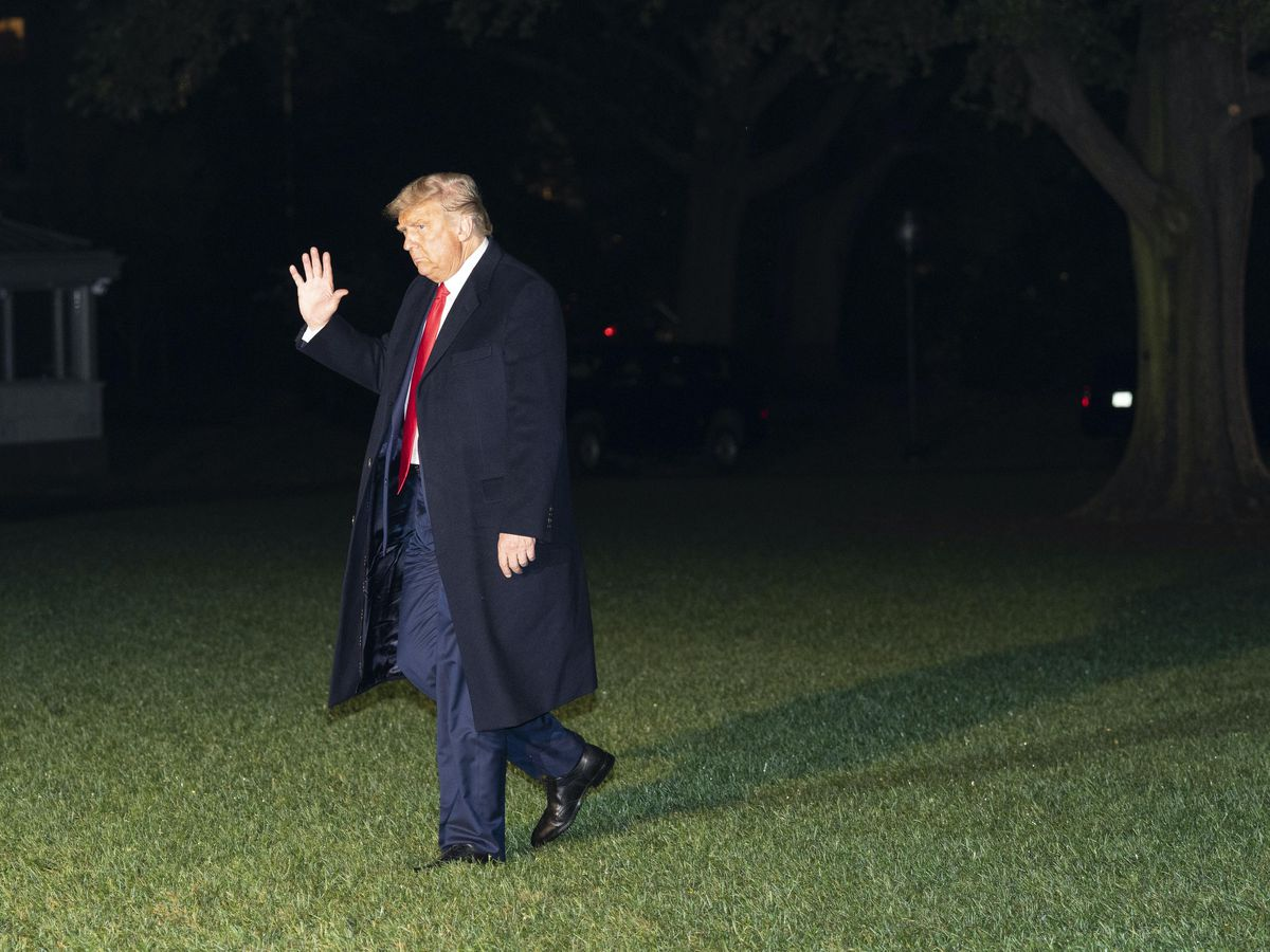President Donald Trump waves as he walks on the South Lawn of the White House