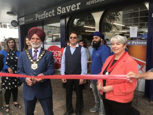 Celebrating a year since the takeover of Madeley Post Office are, from left, Councillor Amrik Jhawar,Mayor of Telford & Wrekin Council, Balvir Randhawa and son Jason, and Councillor Sarah Chadwick, Mayor of Madeley Town Council.
