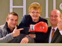 Joshua's glove raises £380 for cancer charity