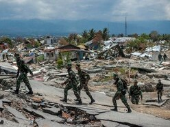 Disinfectant dropped on Indonesia quake city to reduce disease risk