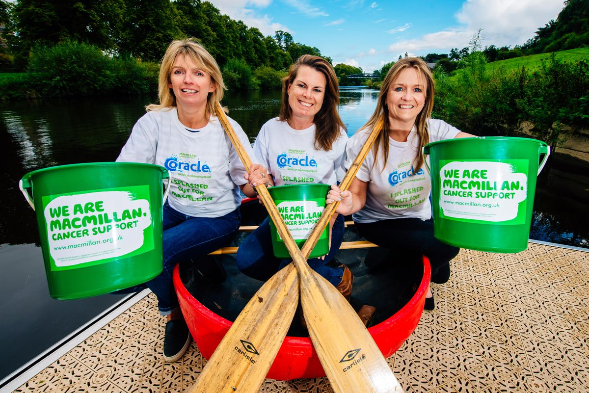 Camila Hughes and Jayney Davies, from the race organising committee, and Kate Thomas from the Macmillan charity