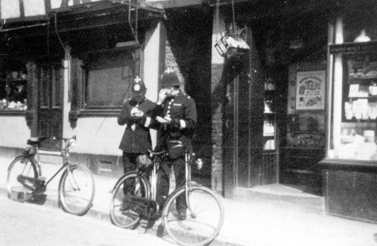 Two policemen with bicycles outside 111/112 Frankwell in Shrewsbury, taking notes, perhaps in the 1930s. This is another picture which came originally from Phil Bennett, of Shrewsbury, whose uncle Teddy Talbot, who died in 1968, was a policeman in the county town. However he is not one of these two as they do not have sergeant's stripes.
