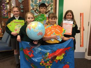 WIth new geography resources are Woore pupils Maggie Friend, 10, Summer Birkes, nine, Zachary Jaques, 10, Lille Mae Cheadle, eight and Olivia Owen, nine