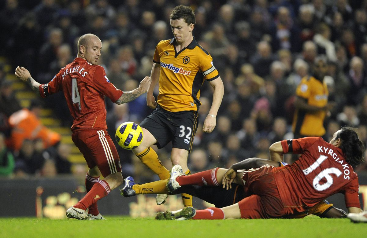 Kevin Foley of Wolverhampton Wanderers is challenged by Raul Meireles of Liverpool and Sotirios Kyrgiakos of Liverpool (AMA)