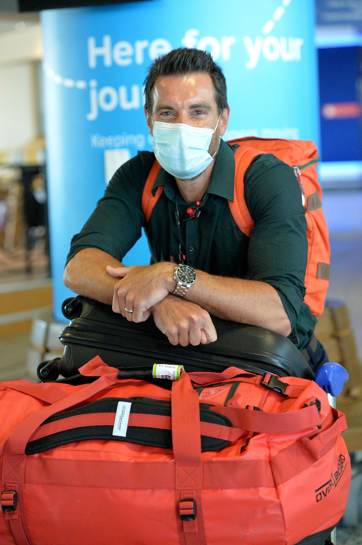 Andrew Grubb arrives at Birmingham Airport from Faro