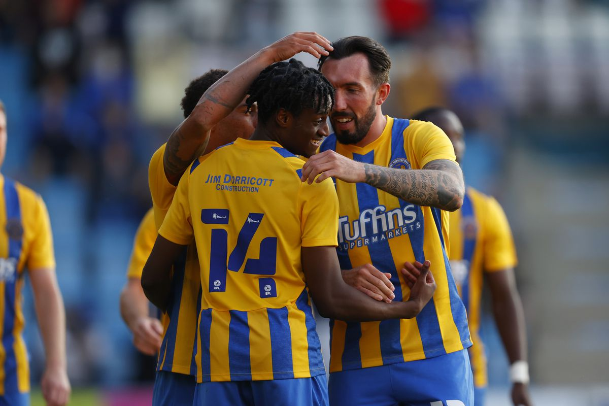 Ryan Bowman of Shrewsbury Town celebrates with his team mates after scoring a goal to make it 1-2. (AMA)