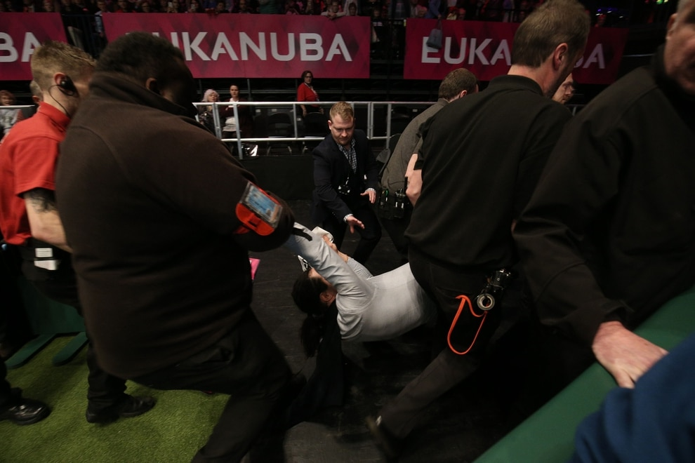 An intruder is wrestled to the ground after Tease the Whippet was named Supreme Champion during the final day of Crufts