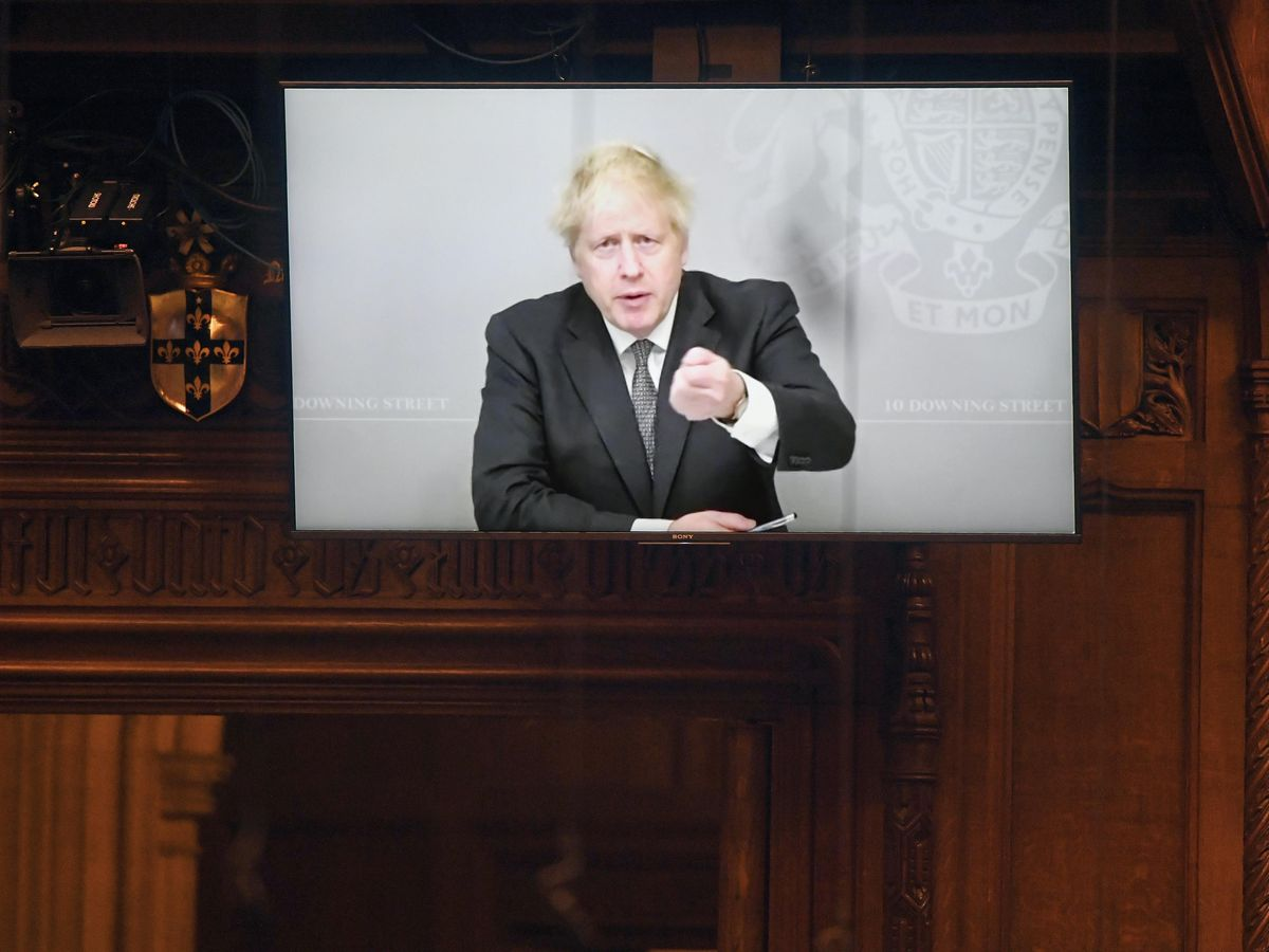 Boris Johnson appearing via video link from Downing Street