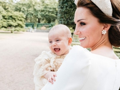 Laughing Louis pictured with Kate to mark christening
