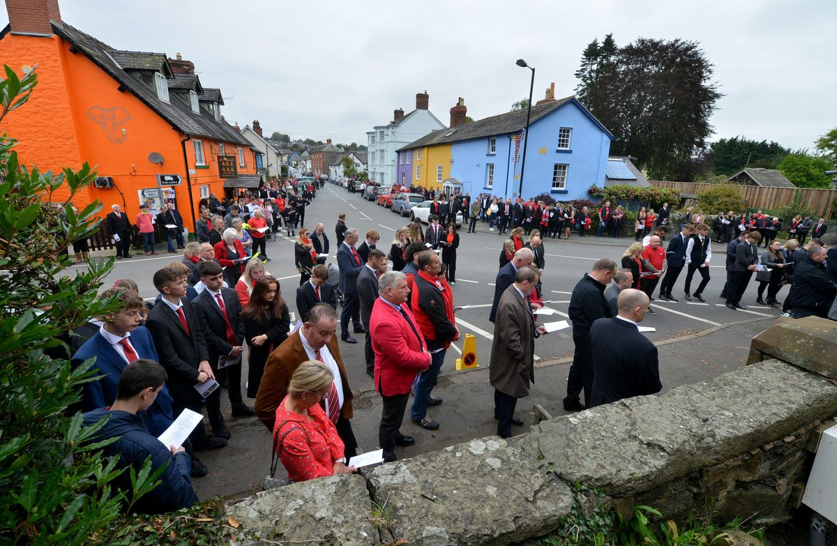 Hundreds of mourners lined the streets of the town