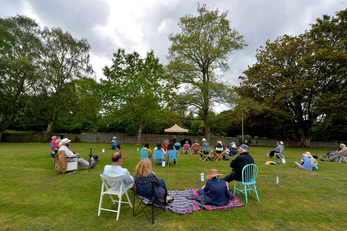 The audience enjoys the open air production from Mid Wales Opera
