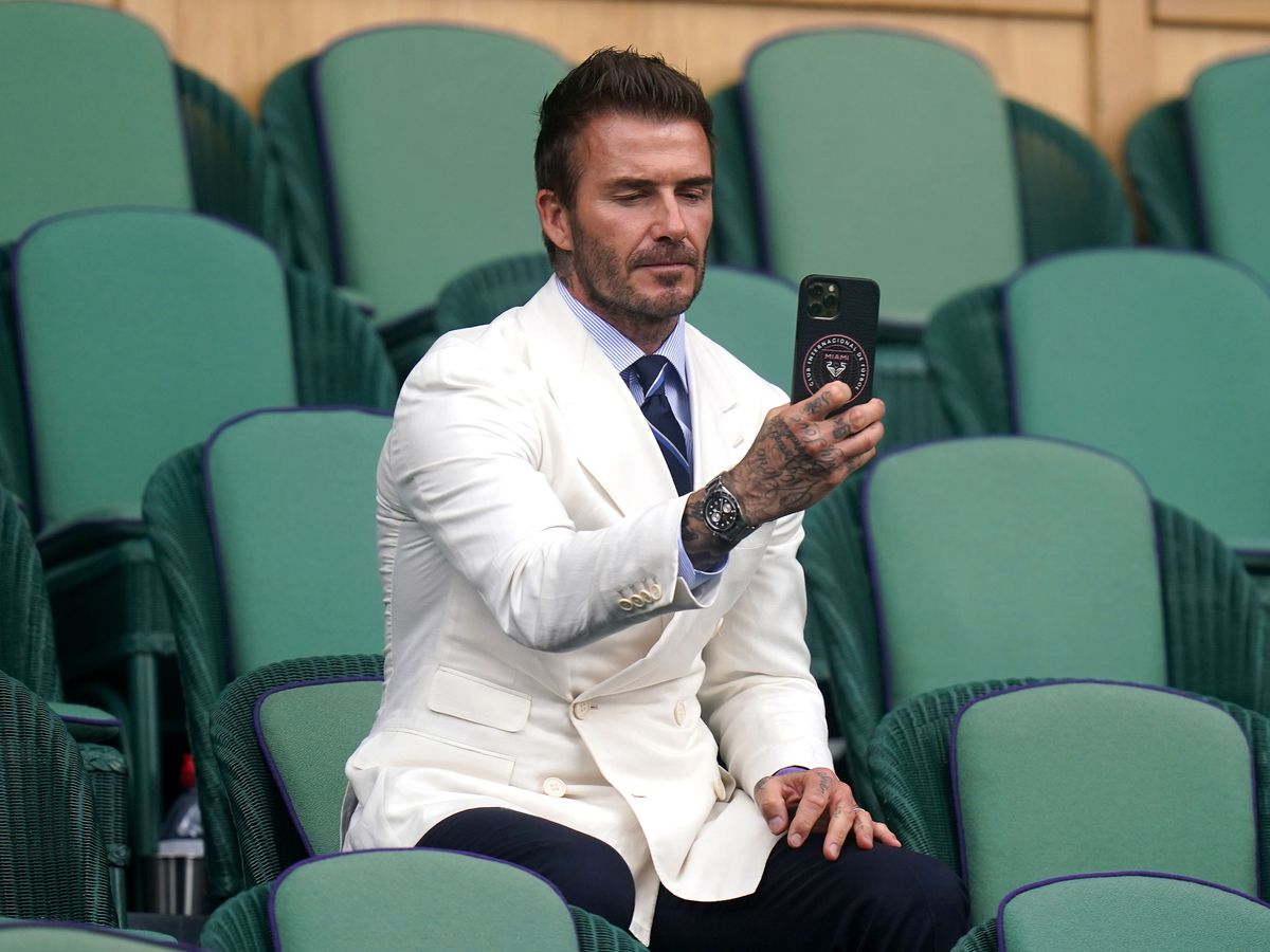 David Beckham takes a picture at Wimbledon