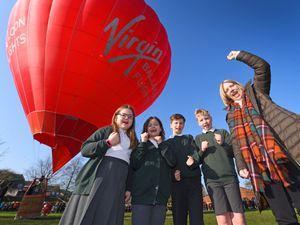Newport Junior School pupils Harriet Hand, 9, Esme Wilkinson, 8, Jack Lloyd, 9 and Sam Cole, 11, along with headteacher Nicola Moody celebrate the arrival of the hot air balloon