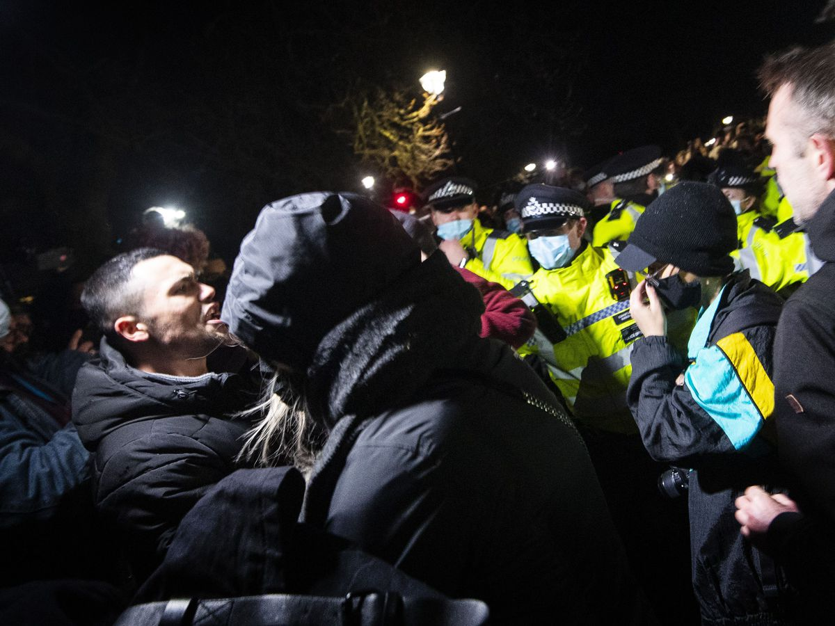 Police and protesters after a vigil for Sarah Everard in south London in March