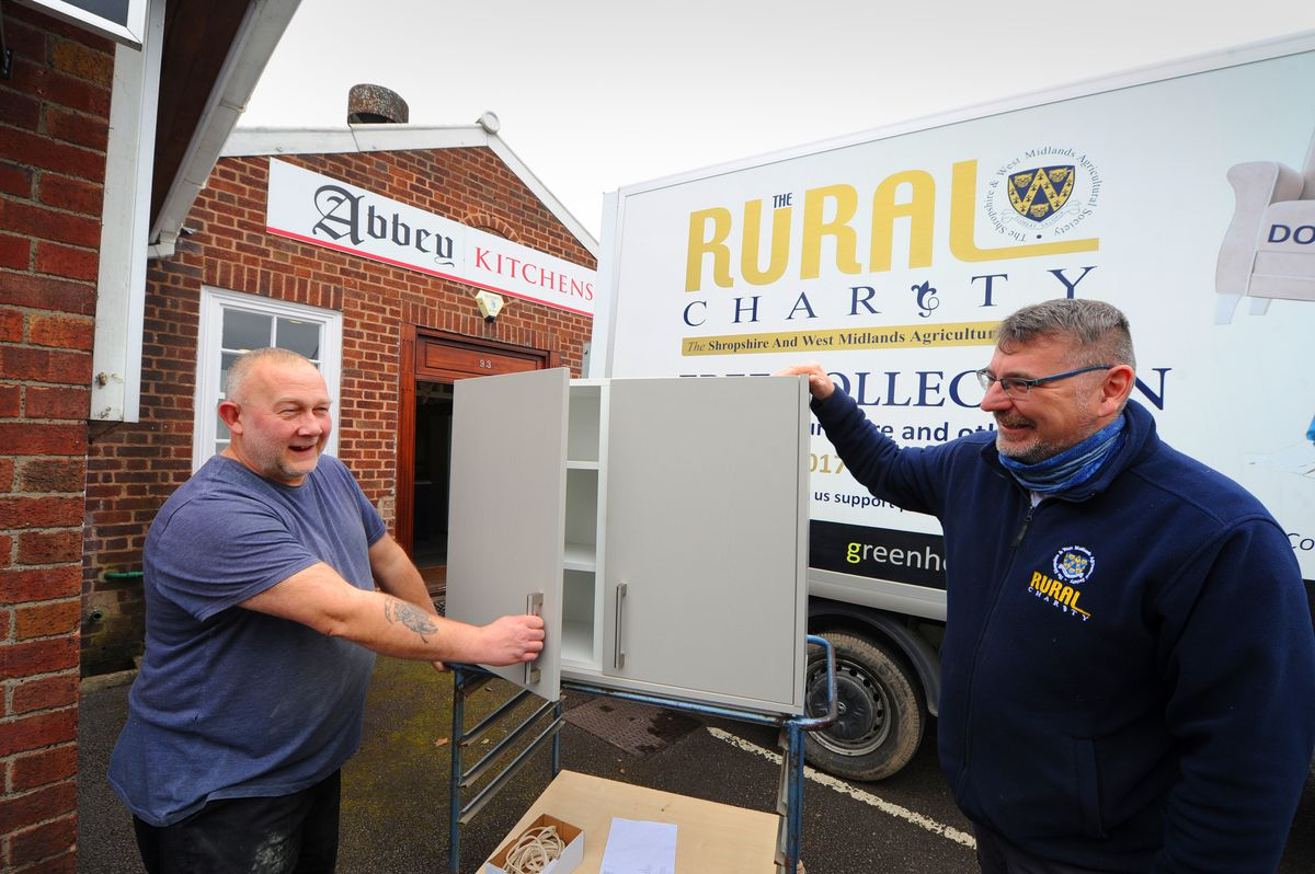 Abbey Kitchens has donated a kitchen to the flood-hit Greenhous West Mid Showground with Steve Rich from the firm (left) handing it over to Rural Charity chief executive Ian Bebbington.