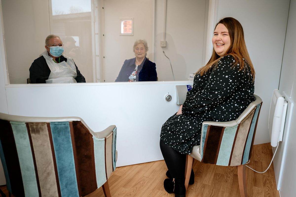 The visiting pod at Wheatlands Care Home with hostess Carolyn Abberley, resident Cynthia Espley and team leader Lucy Gray