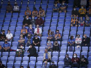 Shrewsbury Town supporters sitting in the stand. (AMA)