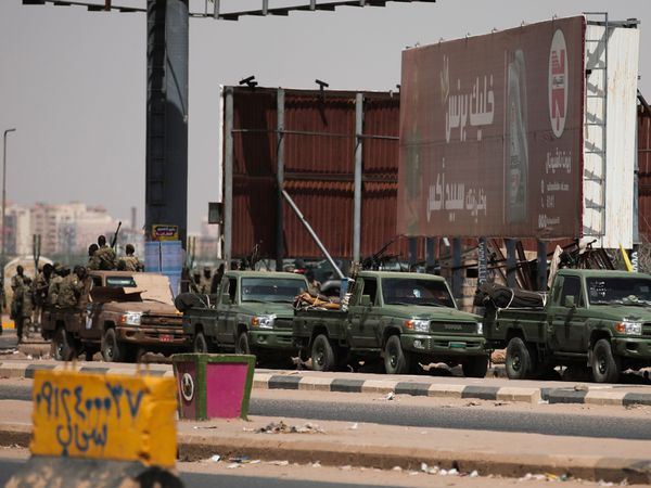 Sudanese security forces are deployed during a protest a day after the military seized power (Marwan Ali/AP)