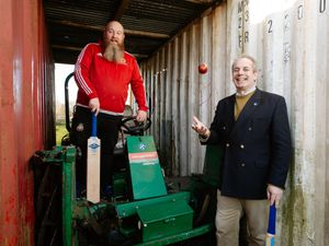 Ellesmere County Cricket chairman James Harrison and Ian Kelly, Worshipful Master of the Brownlow Lodge, with the mower