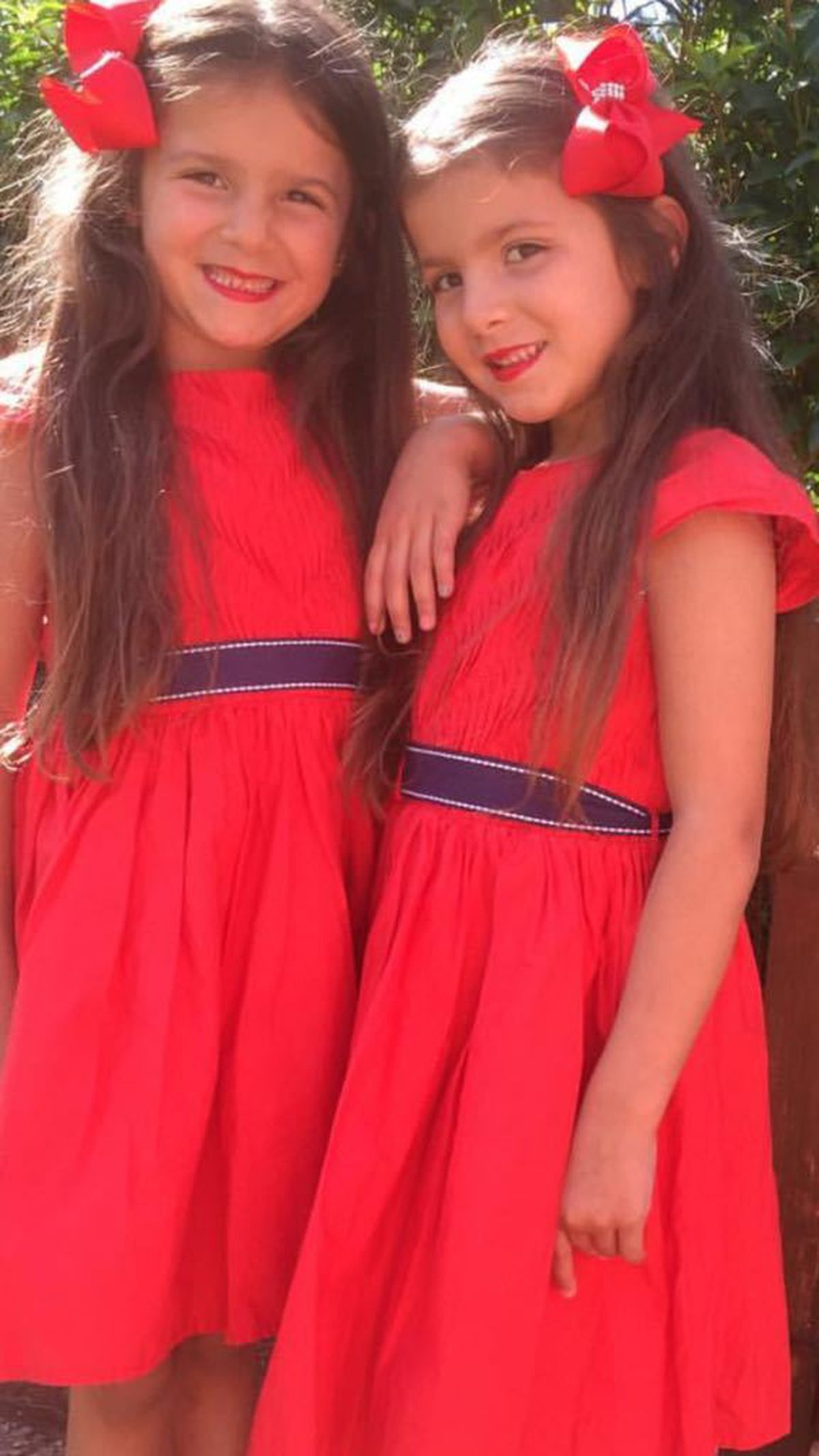 Sienna, left, with her twin sister Louisa