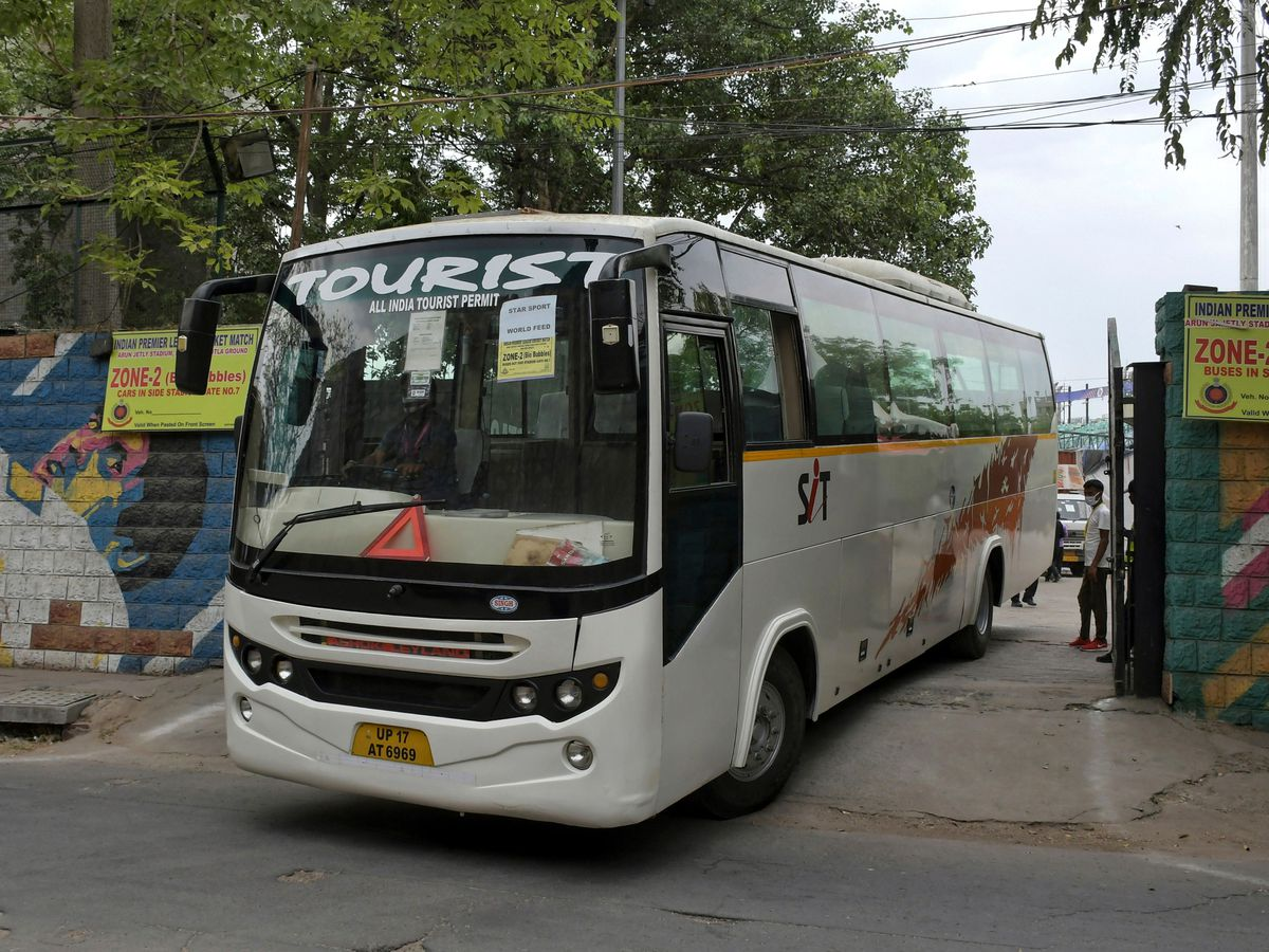 A bus assigned for transporting the members of broadcast team leaves Arun Jaitley Stadium